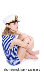 captain in striped clother is embrace legs. Isolated in white