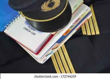 Captain uniform and aircraft check list for aircraft emergency procedure
