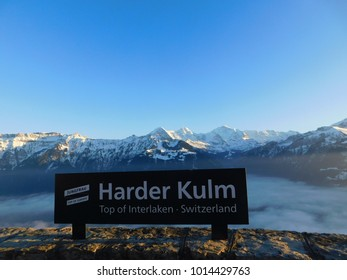 """Caption """"Harder Kulm"""" and mountains as background"""