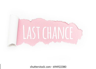 """A caption """"last chance"""" in the rupture of paper on a pink background."""