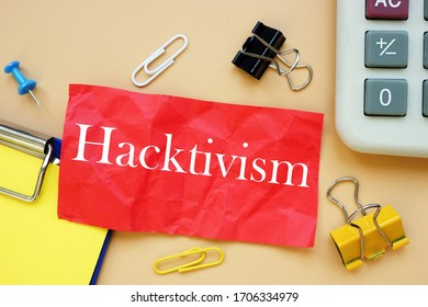 The caption in the picture is Hacktivism. Notebook sheet, table, pens.