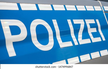 Caption Polizei at a German police vehicle
