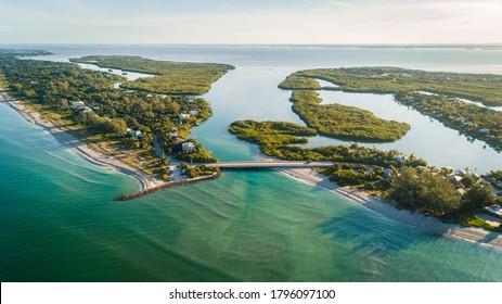 """Captiva, FL / USA - 8-12-2020: Stunning aerial view during sunrise of Captiva Island and Sanibel Island."""