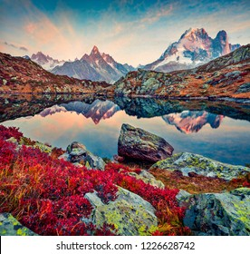 Captivating autumn view of Chesery lake/Lac De Chesery, Chamonix location. Stunning outdoor scene of Vallon de Berard Nature Preserve, Graian Alps, France, Europe.