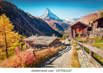 Captivating autumn view of Zermatt village with Matterhorn (Monte Cervino, Mont Cervin) peak on backgroud. Beautiful outdoor scene in Swiss Alps, Valais canton, Switzerland, Europe.
