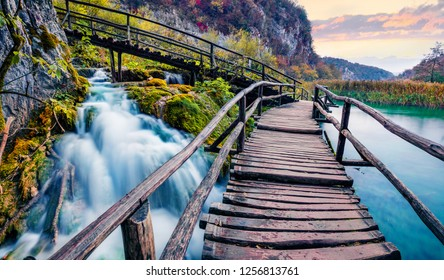Captivating evening view of pure water waterfall in Plitvice National Park. Spectacular autumn sunset in Croatia, Europe. Beauty of nature concept background.