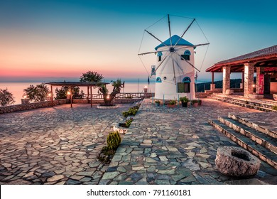 Captivating morning view of Potamitis Windmill. Colorful spring sunrise on Zakynthos island, Korithi location, Ionian Sea, Greece, Europe. Beauty of countryside concept background.