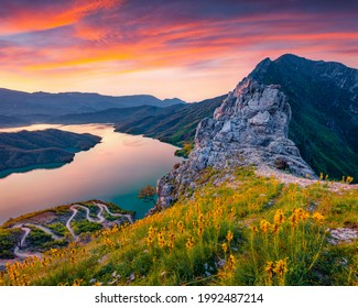 Captivating sunrise on Bovilla Lake, near Tirana city located. Majestic spring landscape with blooming yellow flowers. Superb outdor scene of Albania, Europe.