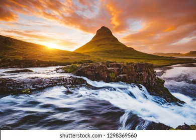 Captivating view of unique Kirkjufell volcano at sunset. Location place Kirkjufellsfoss waterfall, Iceland, Europe. Picturesque image of most popular tourist attraction. Explore the beauty of earth.