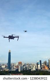 capturing beautiful kuala lumpur skyline view with drone