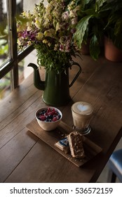 capuccino and dessert on wooden table
