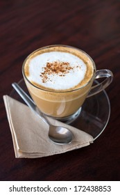 capucino coffee on wood background