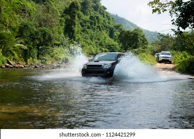 Car 4+4,Drive to cross the river,In the forest at Thailand.