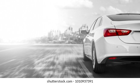 A car accelerating on a highway when traveling to the city