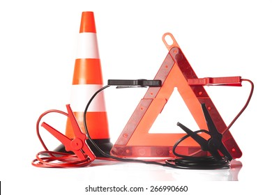 Car accessories - traffic cone with road emergency triangle and jump start cables on white background