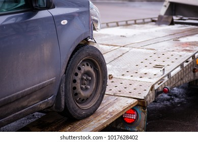 Car accident. Auto crash, wreck with damage injury. Street, traffic collision. Broken metal. Automobile insurance, safety, repair and transportation. Road dangerous drive. Tow track.