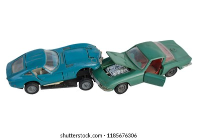 Car accident, blue and green toy cars, that crashed into each other, close-up, isolated on white