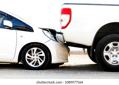 Car accident : The collision between the two cars cause damage.