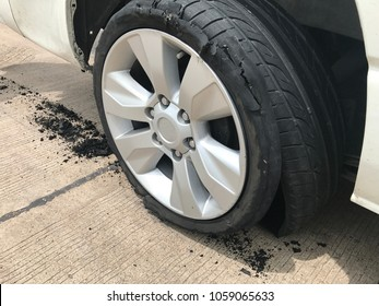 car accident. Car flat tire. wheel flat tire on the road. Closeup wheel explore. Dangerous car accident with flat tire.