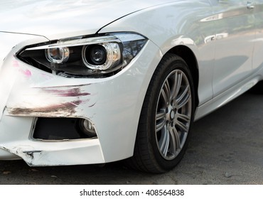 Car an accident with head light damage on the road