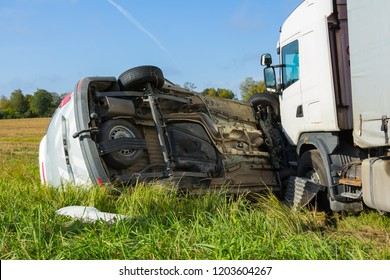 Car accident on a road in September, car after a collision with a heavy truck, transportation background