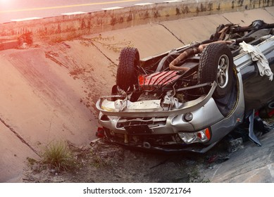 car accident on the street,front of black car get damaged by accident on the road comes from drunk and carelessness in road, tip over car under road
