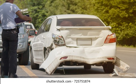 A car accident. Traces of braking tires on the road surface. Warm light.
