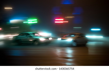 Car accident. Two cars crashed on the city road. Intentional motion blur