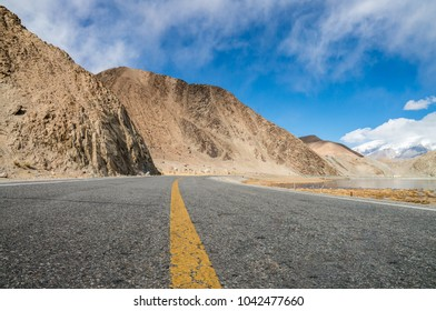 Car advertising background, plateau, mountains, snow-capped mountains and highways