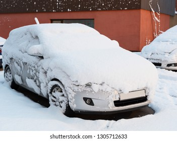 Car after snowfall.