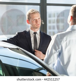 Car agent talking with customer