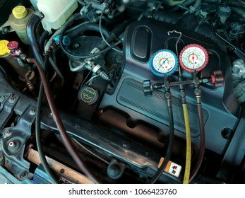 Car air conditioner check and recharge refrigerant.