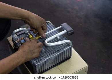 Car air conditioner evaporator coil close up. Auto mechanic worker fixing air condition in car garage. Maintenanceservice, Repair checking vehicle engine tools car air conditioner system.