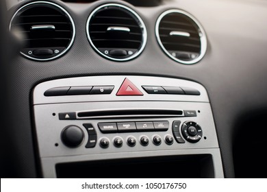 Car air conditioning. The air flow inside the car. Detail audio system buttons in car.