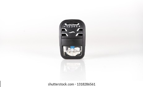 Car air freshener with mini clip built-in perfume bottle and manual controller. Concept of odour eliminator. Isolated on white background. Copy space.