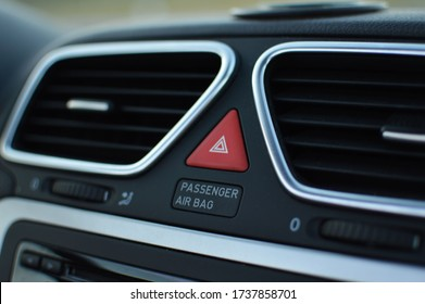 Car airbag button. An airbag is a vehicle occupant-restraint system using a bag designed to inflate extremely quickly.