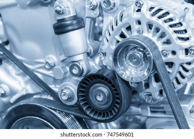 The car alternator in the light blue scene .Close up of the  of engine part.