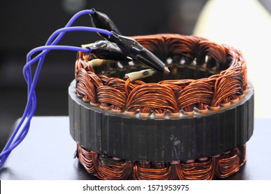 Car alternator repair, test of copper coil stator close up