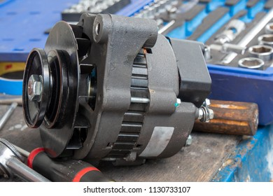 a car alternator repaired on the workbench