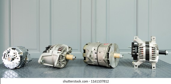 Car alternators on display on metal shelf/auto parts