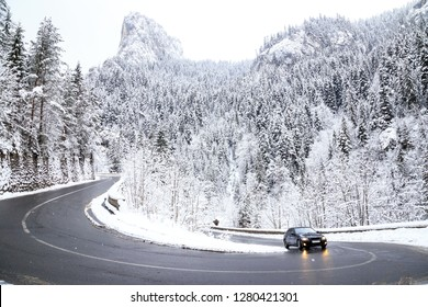 Car ascending through the serpentines in Bicaz Chei, Romania. Winter in Bicaz Chei, Romania in winter day.