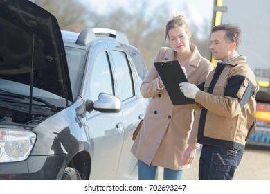 car assistance service with customer outdoors