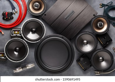 car audio, car speakers, subwoofer and accessories for tuning. Dark background. Top view.