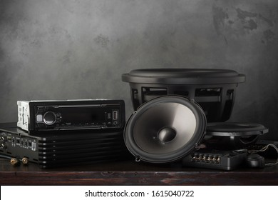 car audio, car speakers, subwoofer and accessories for tuning. Dark background.