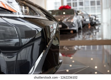 Car auto dealership. New cars at dealer showroom. Prestigious vehicles.