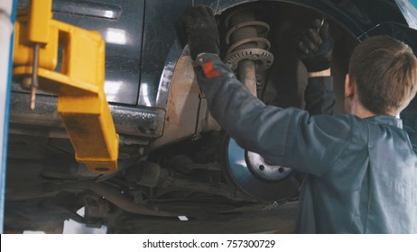 Car in auto service lifting for repairing