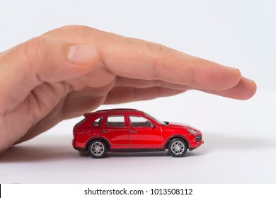 Car (automobile) insurance and collision damage waiver concepts. Businessman with protective gesture