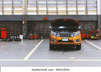 car in automobile repair service center with soft-focus in the background and over light