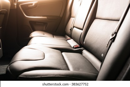 Car backseats with sun light flare from the window