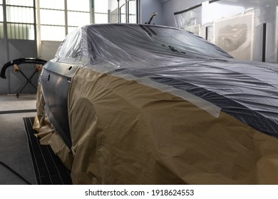 Car baking room, auto bodywork, and repair. Paintjob and coating after taping and sanding all surfaces. Priming and preparation before the full makeover and final glossy finishing. Production line.